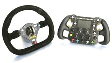 White Knuckle Shuffle: The Evolution of Steering Wheels. From wood and metal wheels to ergonomically ...