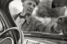 May 1940. Wiping off windshield at service station in Cairo, Illinois. 35mm negative by John ...