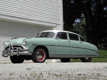 1952 Hudson Hornet with twin power carbs. Bidding at $12,413 and reserve not met.