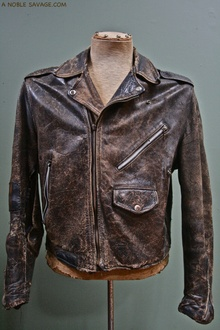 Early biker jacket, might be a Schott. Note unusual pocket location. Very cool!