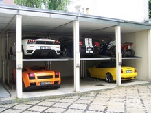 This doesn't really look like a working garage, but I like the use of lifts, ...