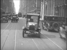 Driving in New York city in 1928.