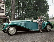 Jean Bugatti alongside his epic creation on the Type 41 Royale chassis.